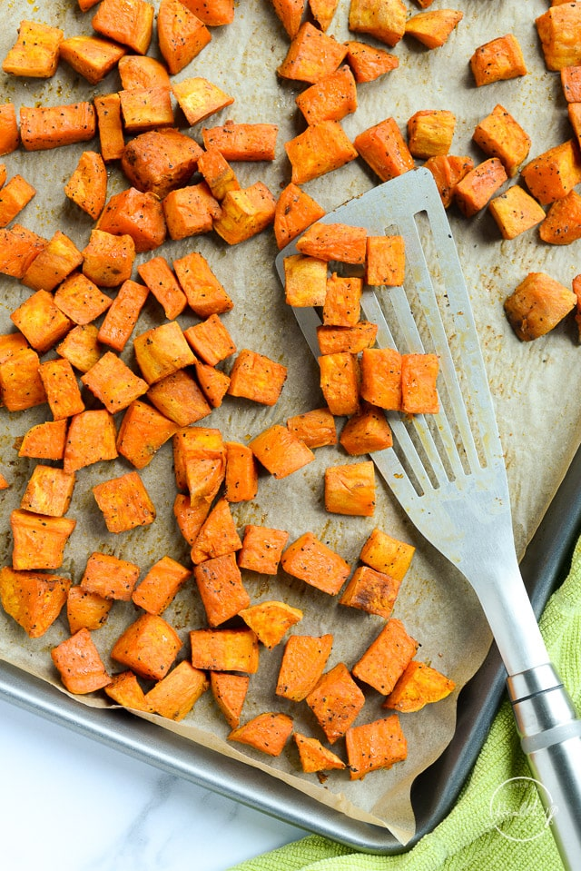 Roasted sweet potatoes on sheet pan with metal spatula best BBQ side dishes