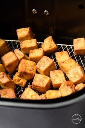 air fryer tofu in fryer basket