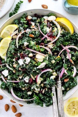 Kale salad in white serving bowl shot closeup
