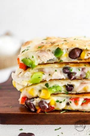 chicken quesadillas sliced and stacked on top of each other