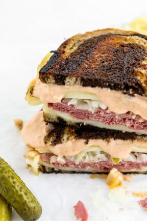 Closeup shot reuben sandwich with dripping Russian dressing