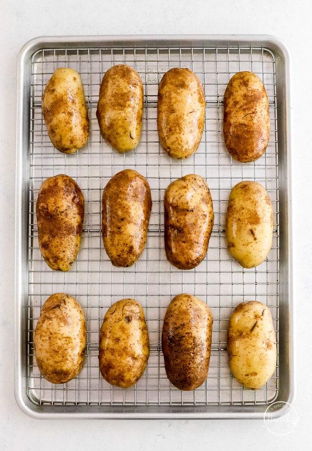 cooked potato halves on baking sheet