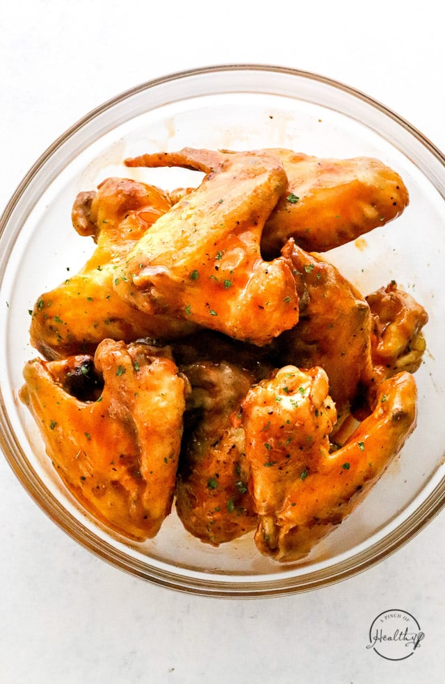 tossed and coated air fryer buffalo wings
